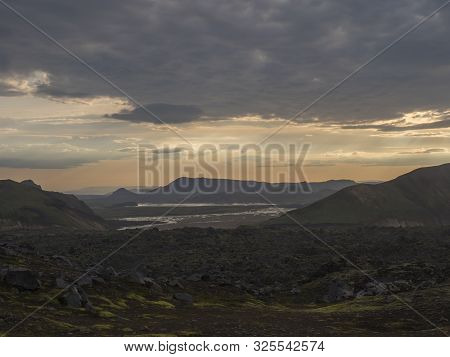 Lava field landscape in Landmannalaugar with river delta and Rhyolit mountain at Sunrise in Fjallabak Nature Reserve, Highlands Iceland poster