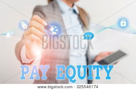 Writing note showing Pay Equity. Business photo showcasing eliminating sex and race discrimination in wage systems Female human wear formal work suit presenting smart device. poster