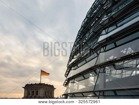 BERLIN, GERMANY - DECEMBER 16, 2018: Glass dome on the top of Reichstag Building, a seat of the German Parliament (Deutscher Bundestag) and popular tourist attraction