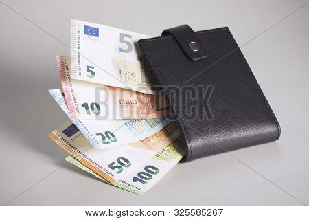 Euro Banknotes Paper Currency Is Black Purse On Gray Background, Cash Paying Or Cash Payment Concept