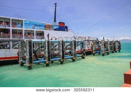 KOH PHANGAN, THAILAND - AUGUST 20, 2013: Ferry boat at the Koh Phangan island pier.