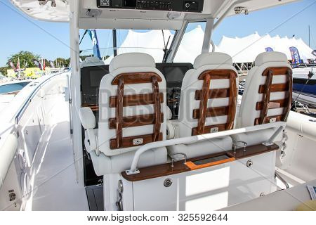 NORWALK, CT, USA - SEPTEMBER 19, 2019: New 2020 Everglades 435 CC shoving on Progressive Norwalk Boat Show Day 1 From September 19-22, 2019.