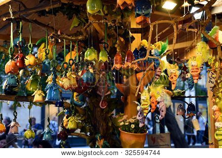 Porcelain Decorations In Flower, Angel And Animal Shapes On An Advent Street Market At Deak Square I
