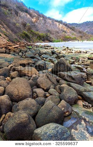 Rocks Of All Shapes And Sizes With The Beach In The Background At The Los Frailes Beach National Par