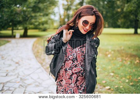 Smiling Female Dressed Boho Fashion Style Colorful Long Dress With Black Leather Biker Jacket With B