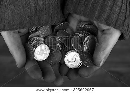 Concept: Poverty And Misery,silver Coins In Dirty Hands.