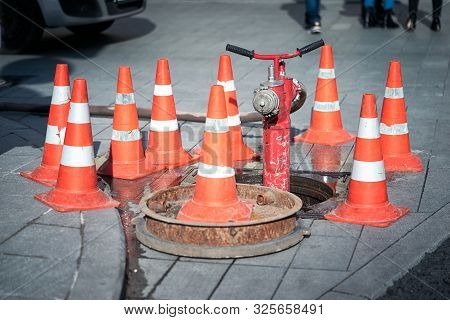Hydrant Surrounded By Cones On A Carriageway