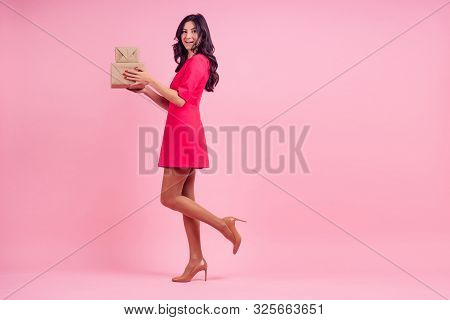 Full Height Beautiful Young Woman In Pink Mini Dress Posing Length Studio Shot On Pink Background. B