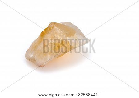 Mineral Citrine On A White Background. Decorative And Ornamental Stone. Nugget Close Up View. Jewelc