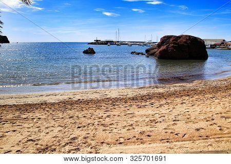 Beautiful La Ermita beach in Mazarron, Murcia, Spain. Island in the background. poster