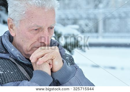 Close Up Portrait Of Sad Senior Man