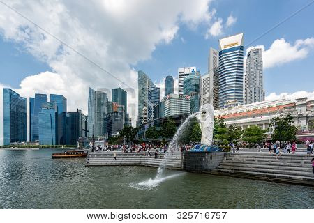 Singapore - April 15,2017 : Merlion Statue Fountain With Singapore Business District Skyline With To