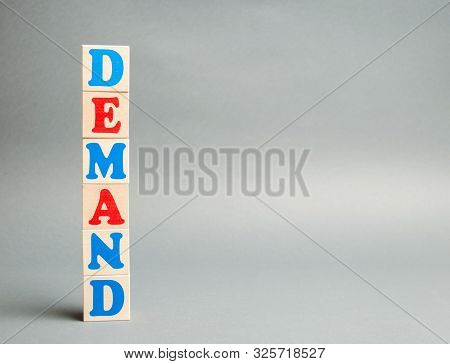 Wooden Blocks With The Word Demand. The Concept Of Demand For Goods Or Services. The Relationship Be
