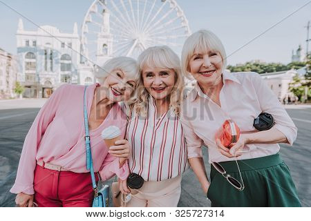 Three Older Women Are Spending Time On Square