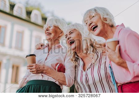 Three Beautiful Old Ladies Have Fun Together