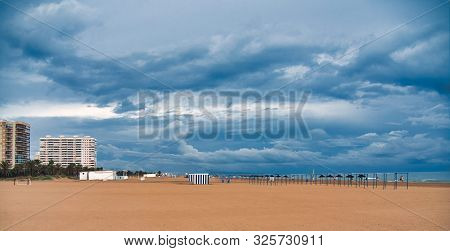 General View Of The Beach Of Gandia, Valencia, On A Rainy And Cloudy Day