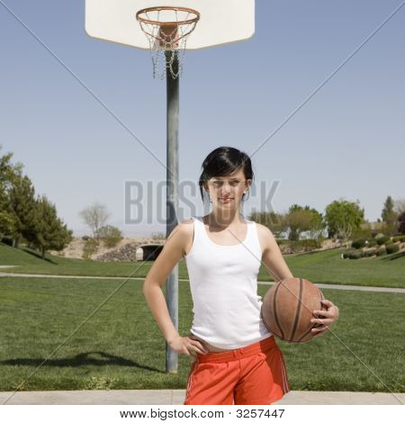 Teen At Basketball Court