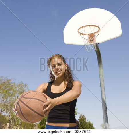 Teen With Basketball At A Court