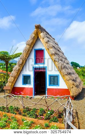 Old Traditional House In Santana, Madeira Island, Portugal. Wooden, Small, Triangular And Colorful H