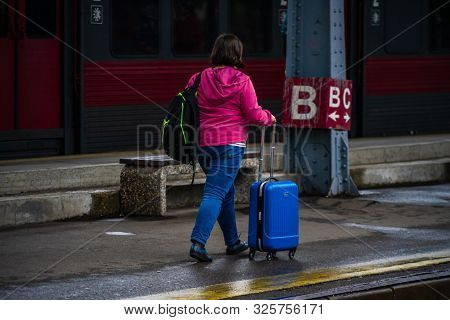 Woman Carrying A Luggage On The Platform Of Bucharest North Railway Station (gara De Nord Bucuresti)