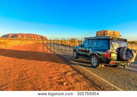Uluru, Northern Territory, Australia - Aug 25, 2019: 4x4 Vehicle On The Road Leading To Ayers Rock,