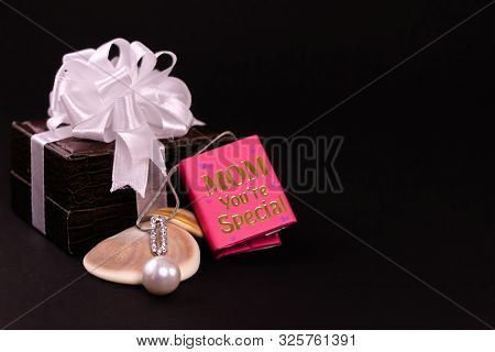 Mother's Day Gift Concept. Beautiful Silver Peral Pendant On Seashell With Mom You're Special Mini M