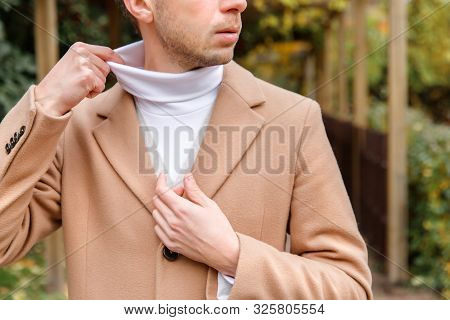 Close Up Portrait Of Man Dressed In Many Layers Of Clothing - Beige Wool Coat, Cardigan And White Hi