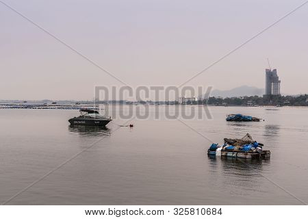 Si Racha, Thailand - March 16, 2019: Royal Thai Police Boat And Small Fishing Vessels On Flat Gray W