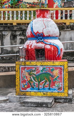 Si Racha, Thailand - March 16, 2019: Red Offering Furnace To Burn Gifts At Bottom Of Guan Yin Shrine