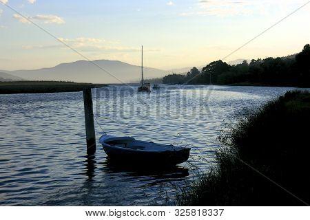 Wooden Boat Moored At Dusk On The Huon River, Tasmania, Australia