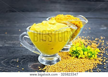 Sauce Mustard In Two Sauceboats With Flower On Table