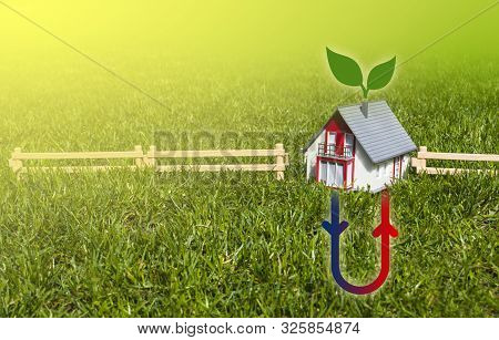 House With Hermal Heating System On Meadow Field