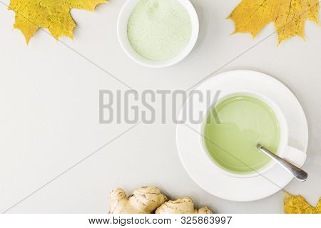 Top view of green tea matcha in a white mug. Matcha ginger latte. Concept - healthy autumn drinks. Copy space for text poster