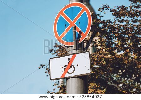 Round prohibitory No stopping or standing traffic sign with plague under it where says Except for disabled. poster
