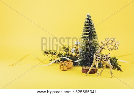 Christmas Composition, Greeting Card With Conifer Evergreen Tree Branches, Golden Deer And Christmas