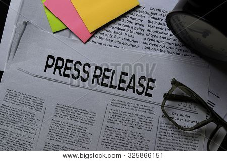 Press Release Text In Headline Isolated On Office Desk. Newspaper Concept