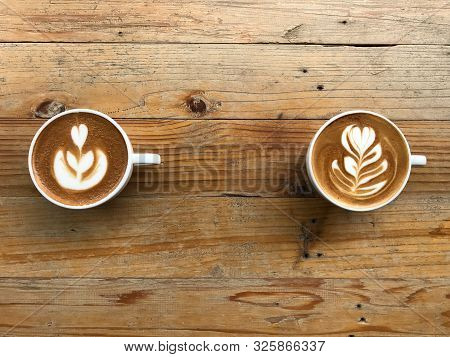 One Cup Of Hot Latte And Another Of Cappuccino Coffee With Two Different Latte Art, Put On Natural B