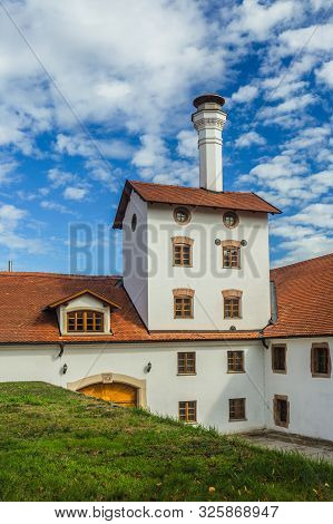 Dacice, Czech Republic - September 29 2019: View Of Former Brewery Building With White Facade, Red R