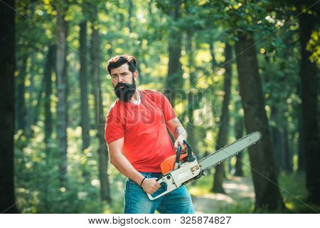 Harvest Of Timber. Lumberjack Concept. Stylish Young Man Posing Like Lumberjack. Lumberjack Worker W