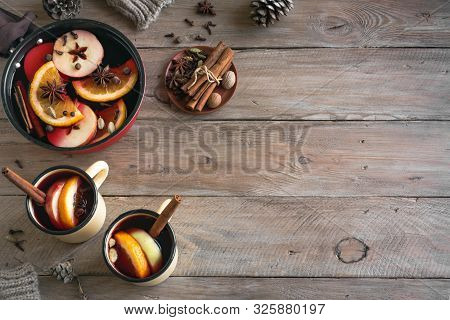 Mulled Wine For Winter Holidays. Hot Mulled Wine Drink With Fruits And Spices On Wooden Background,