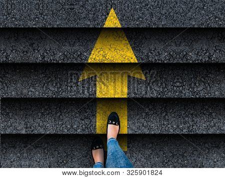 : Woman Legs In Shoes Climbing Stairs With Arrow. Business. Success Or Progress Concept
