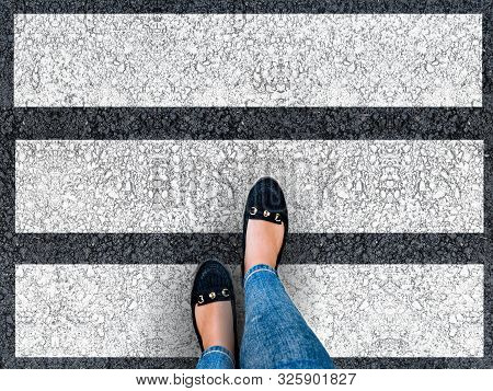 Pedestrians Crossing. Woman Legs Crossing The Zebra Crossing. Top View