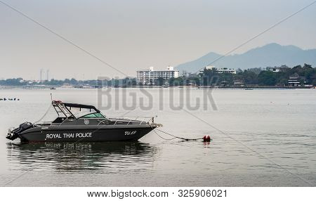 Si Racha, Thailand - March 16, 2019: Closeup Of Royal Thai Police Boat On Flat Gray Water Just Off B