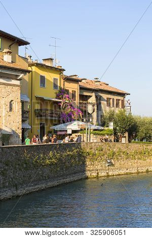 Sirmione, Italy - September 29, 2018: 13th-century Medieval Stone Scaliger Castle (castello Scaliger