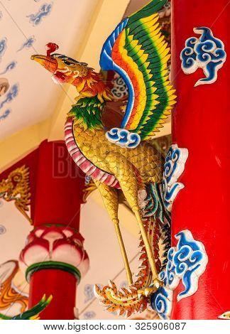 Si Racha, Thailand - March 16, 2019:colorfully Painted Crane Bird At Guan Yin Circular Shrine On Edg