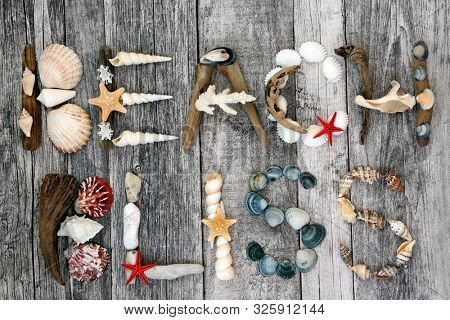 Abstract design of driftwood, seashells and pebbles forming the word beach bliss on rustic wood background. Summer holiday theme. poster
