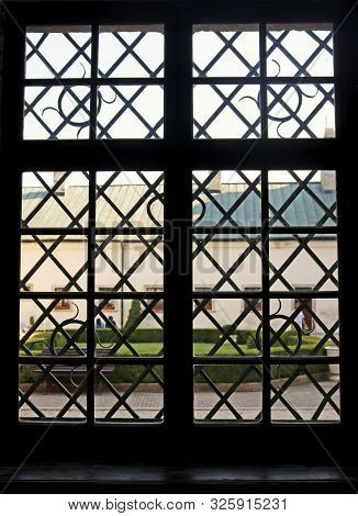 Window With Bars In Medieval Cerveny Kamen (red Stown) Castle Near Casta Village In Slovakia. View O