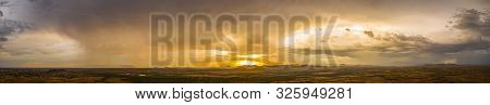 A panorama of a monsoon at sunset over the Sonoran desert of Arizona. poster