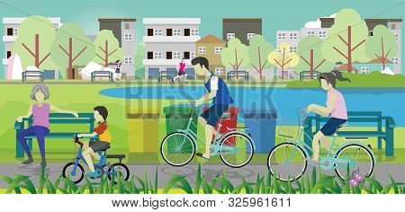 Family Bicycles With Parents And Son. The Old Grandmother Sat On A Steel Chair To Relax. Women And M