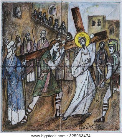 ZAGREB, CROATIA, SEPTEMBER 14, 2019: 5th Stations of the Cross, Simon of Cyrene carries the cross, Church of Saint Matthew in Dugave, Zagreb, Croatia